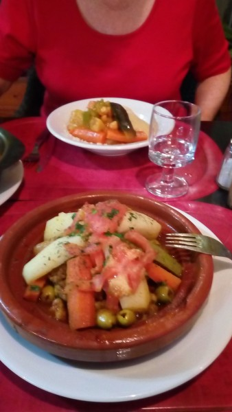 Tagine in foreground, couscous